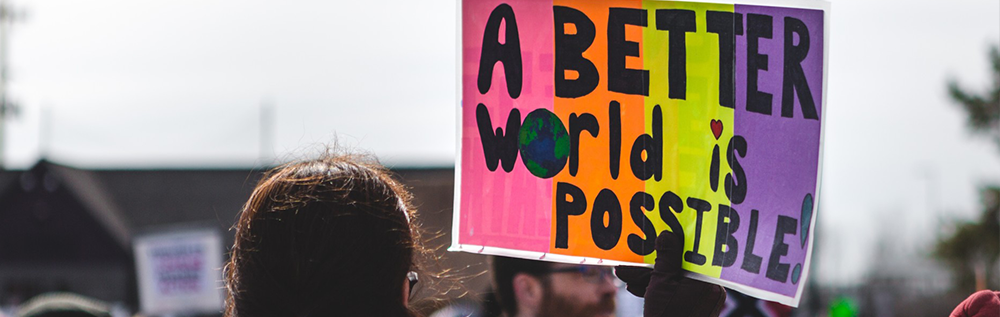 "Sign reading ""A beter world is possible"""